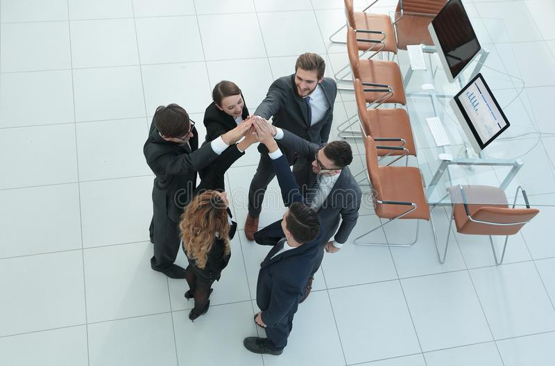 View from the top .business team doing high five. The concept of teamwork royalty free stock images