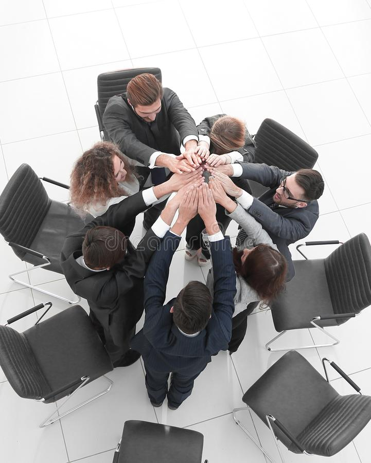 View from the top. business team joining their palms royalty free stock photos