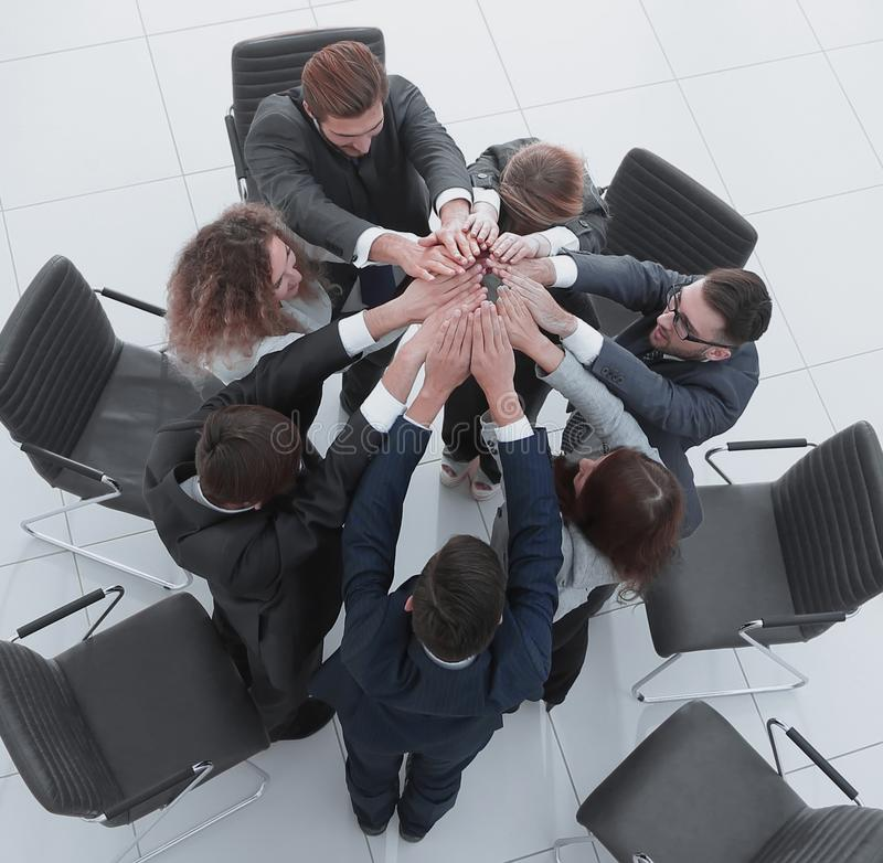View from the top. business team joining their palms. View from the top. business team joining your palms.photo with copy space royalty free stock image