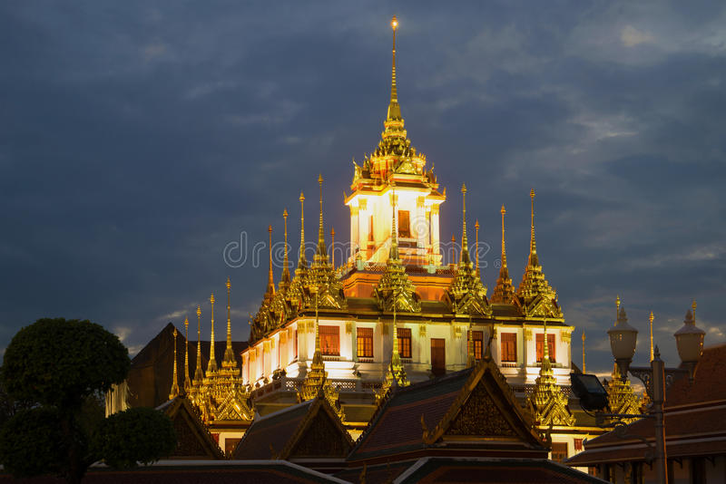 A view of the top of Chedi Loha Prasat Metal Palace of the Buddhist temple of Wat Ratchanadda in the evening twilight. Bangkok, royalty free stock images
