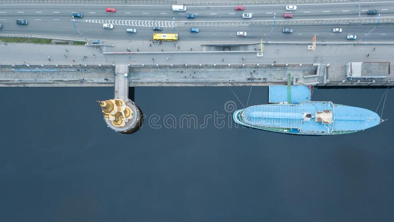 View from the top of the church of St. Nicholas on the water and a tourist ship with high-speed road in Kyiv, Ukraine. View from the top of the church of St royalty free stock images