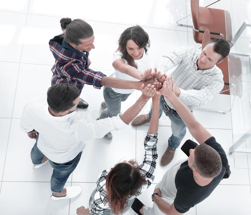 View from the top.creative group of young people. With hands clasped together.the concept of teamwork royalty free stock image