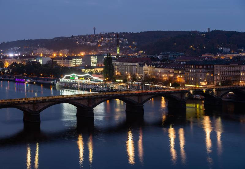 View from the top of the dancing house down to the bridge over the Vltava in Prague at night royalty free stock photography