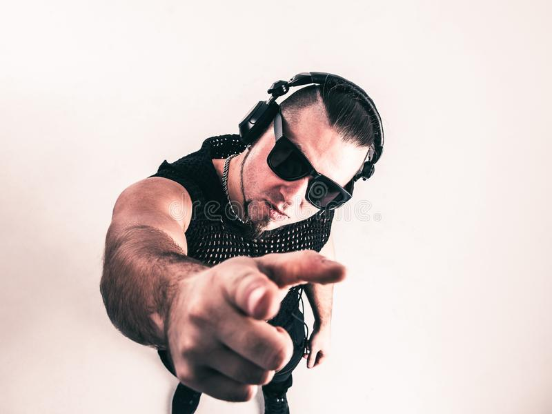 View from the top - DJ - rapper with headphones on a light background. royalty free stock photography
