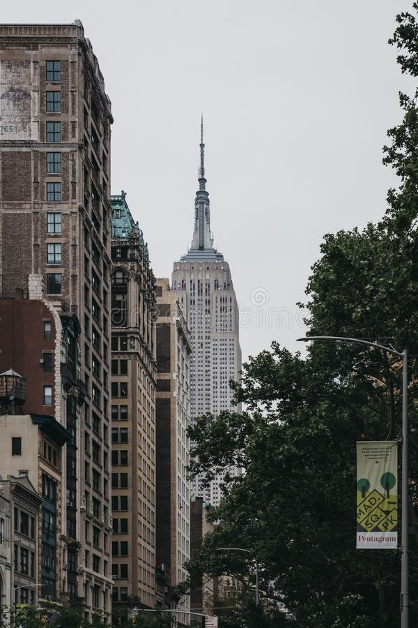 View of the top of of the Empire State Building from Fifth Avenue, Midtown Manhattan, New York, USA. stock photo