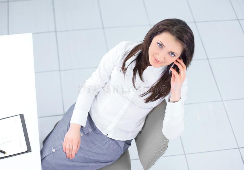 View from the top.employee sitting at Desk and looking at camera. Photo with copy space stock photo