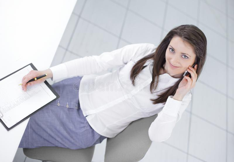 View from the top.employee sitting at Desk and looking at camera. Photo with copy space stock photos
