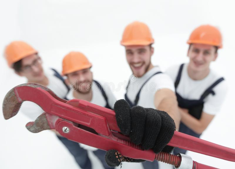 View from the top.group of builders showing a gas key. stock images