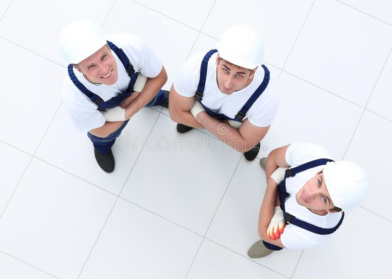 View from the top - group of construction workers royalty free stock images