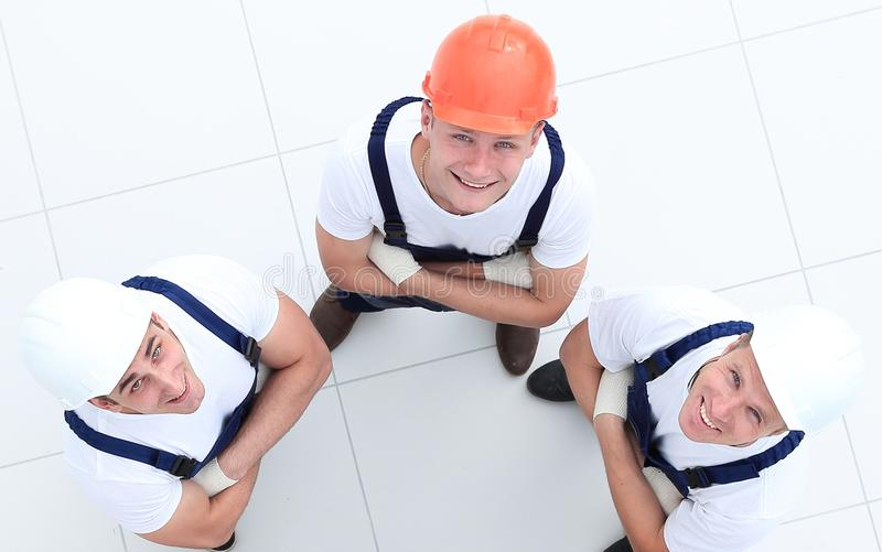 View from the top - group of construction workers stock images