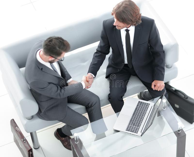 View from the top. handshake business colleagues. Photo with copy space stock photography