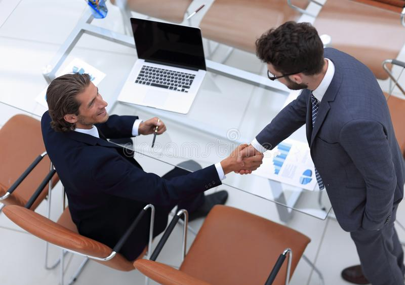 View from the top. handshake of business people royalty free stock images