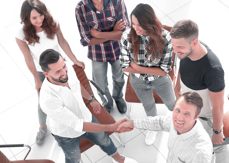 View from the top.a handshake with colleagues stock photo