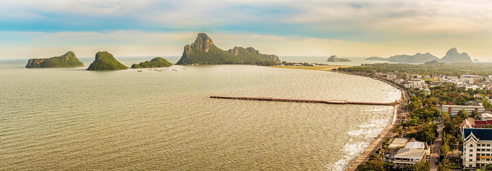 View from top of the Khao Chong Krachok Hill in the town of Prachuap Khiri Khan, Thailand. Landscape view at the bay and the wharf in the town of Prachuap Khiri stock image