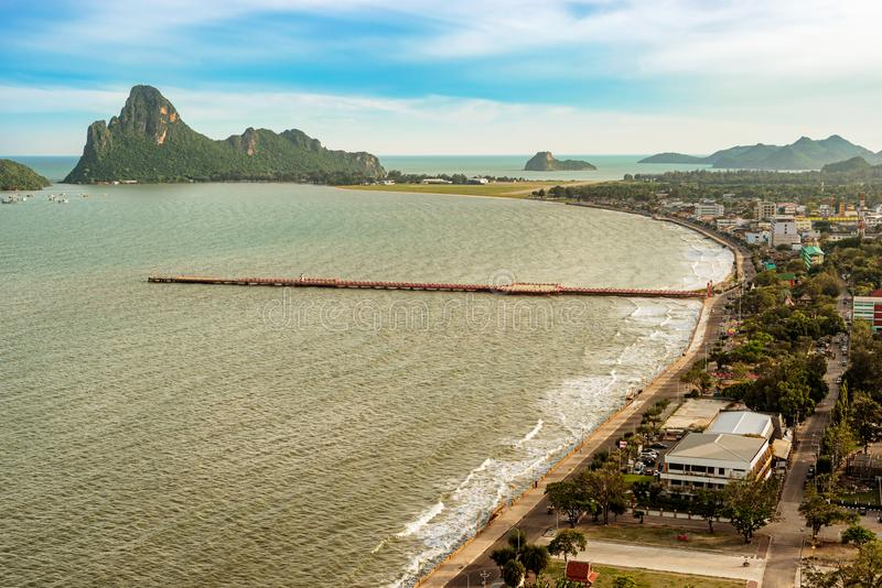 View from top of the Khao Chong Krachok Hill in the town of Prachuap Khiri Khan, Thailand. Landscape view at the bay and the wharf in the town of Prachuap Khiri stock photo