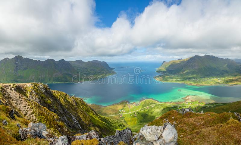 View from the top of Kleppstadheia mountain to the bay with turquoise water, and Rystad and Toe  villages on the shores Austvagoya. Lofoten islands, Norway royalty free stock photos