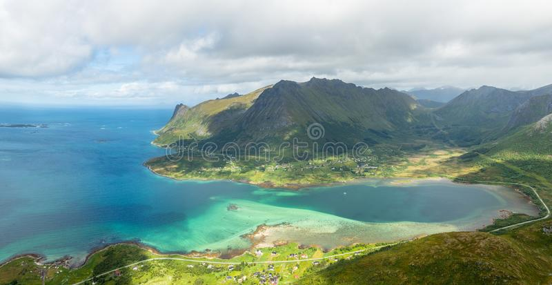 View from the top of Kleppstadheia mountain to the bay with turquoise water, and Rystad and Toe  villages on the shores Austvagoya. Lofotens, Norway, norwegian stock photos