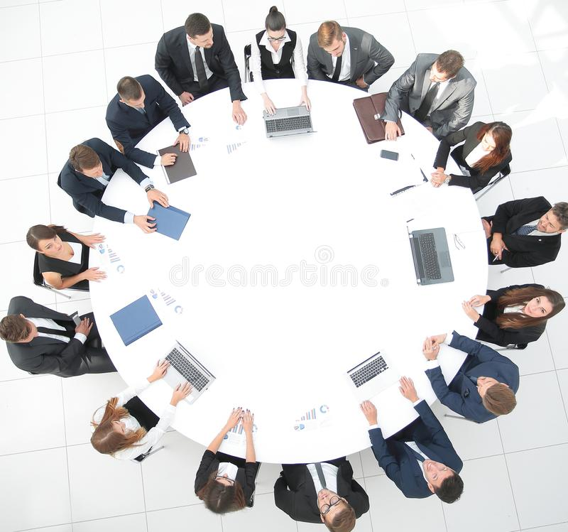 View from the top.meeting of shareholders of the company at the round - table. royalty free stock photos
