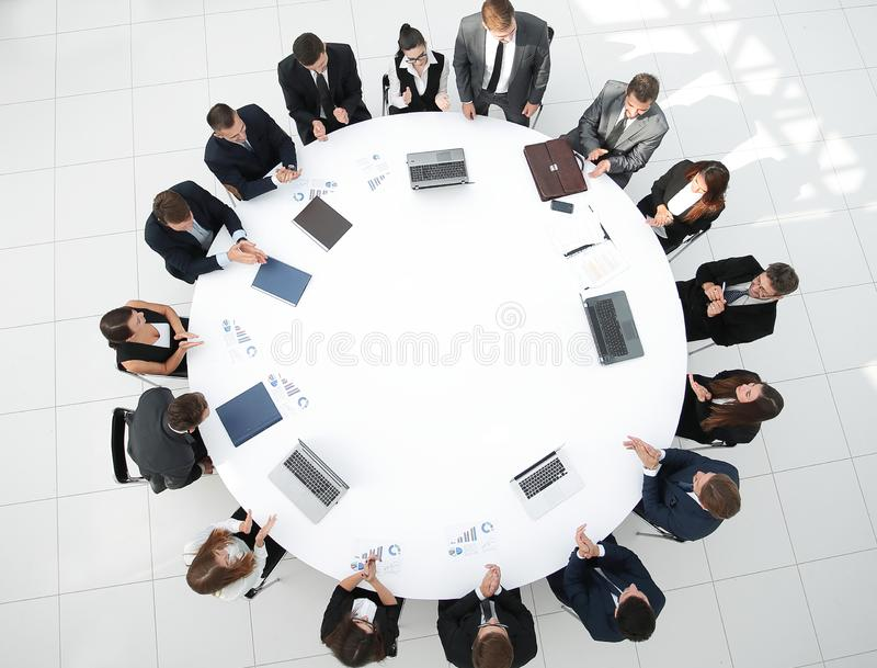 View from the top.meeting of shareholders of the company at the round - table. stock images