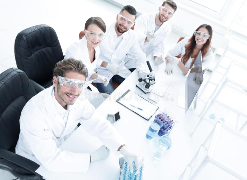 View from the top.modern young scientist sitting at workplace royalty free stock image