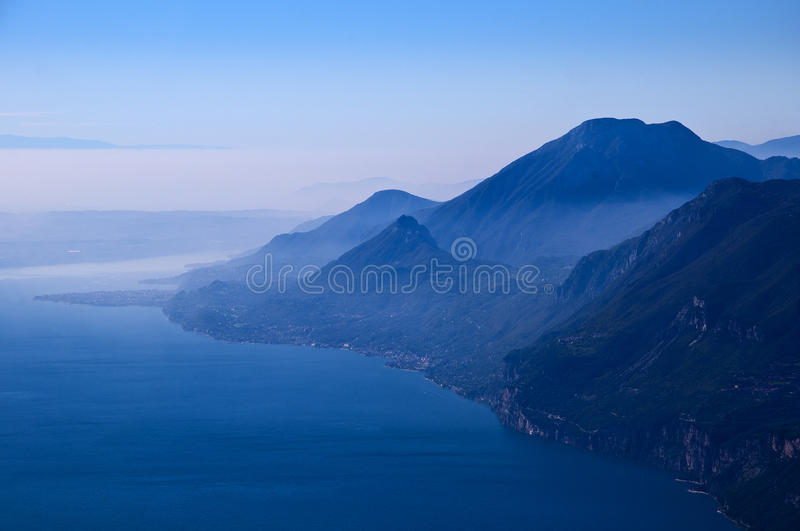 View from the top of Monta Baldo. Vista down the lake at the summit of Monte Baldo above Malcesine on the shores of Lake Garda in Northern Italy royalty free stock images