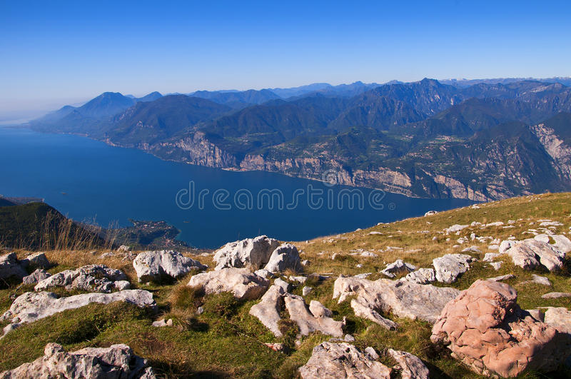 View from the top of Monte Baldo. Vista down the lake at the summit of Monte Baldo above Malcesine on the shores of Lake Garda in Northern Italy royalty free stock images