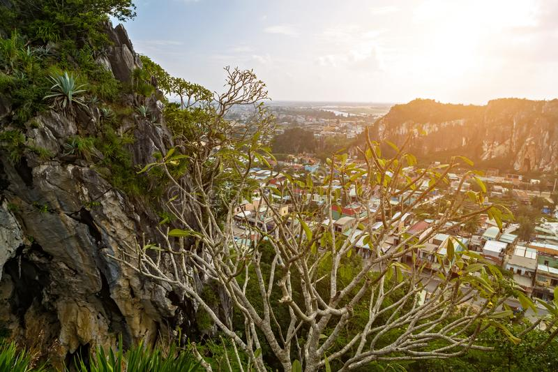 Marble Mountains and Non Nuoc village - Danang. View from on top of Mount Thuy. The Marble Mountains are a cluster of five hills made from limestone and marble royalty free stock photography