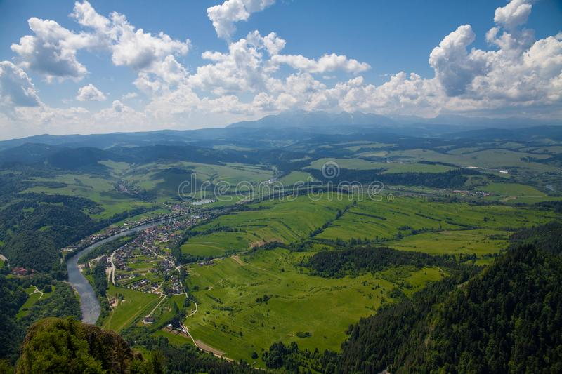 View from the top of the mountain to the Sromowce village by the river. Bialy Dunajec in Pieniny, view from the top of the Three Crowns. The highest peak of stock photography