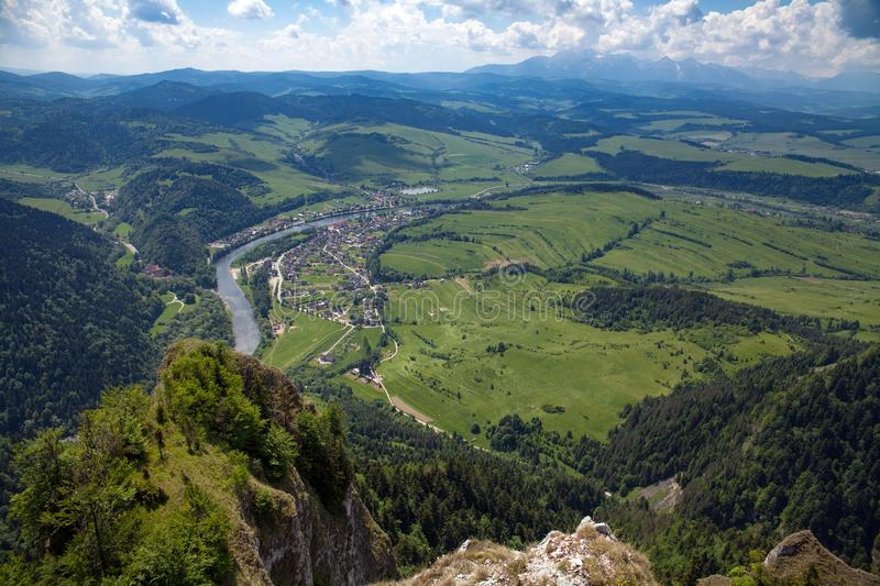 View from the top of the mountain to the Sromowce village by the river. Bialy Dunajec in Pieniny, view from the top of the Three Crowns. The highest peak of stock images