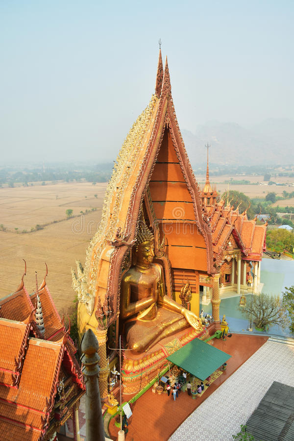 A view from the top of the pagoda, g Wat Tham Sua(Tiger Cave Temple), Tha Moung, Kanchanburi, Thailand. A view from the top of the pagoda, golden buddha statue royalty free stock photo