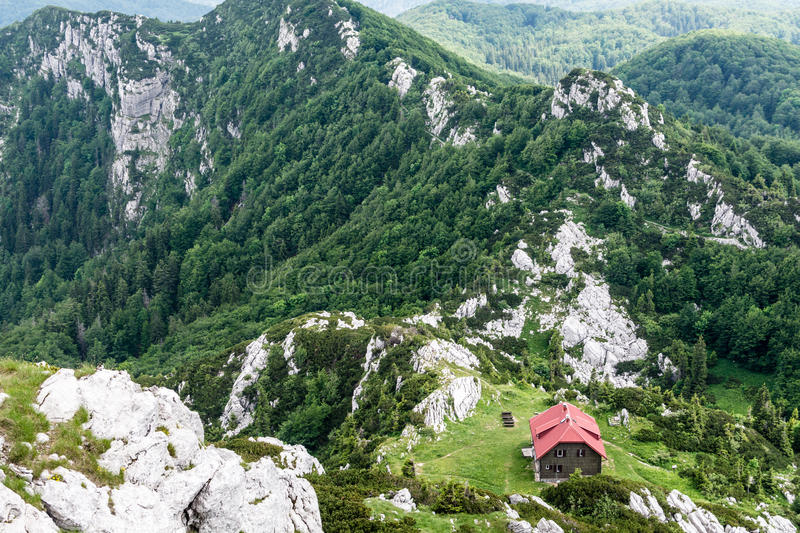 View from the top of peak to a mountain shelter stock images