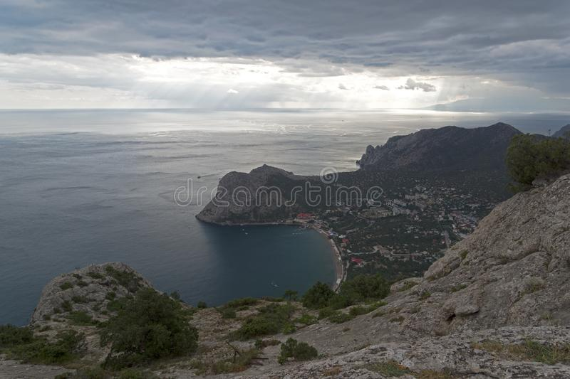 Areal view on a small resort town on the Black Sea coast of Crimea. View from the top of Sokol mountain to the coastal resort town of Novy Svet, Crimea royalty free stock images