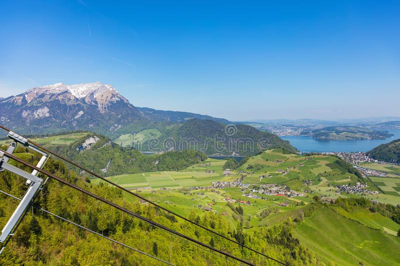 View from the top of the Stanserhorn mountain in the Swiss canto. N of Nidwalden at the beginning of May, summit of Mt. Pilatus in the background stock images