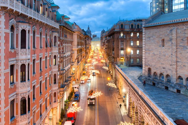 View from the top of Viale XX Settembre in Genoa. Piazza De Ferrari in the background. Christmas lights along the avenue. Christmas lights along the avenue royalty free stock photos