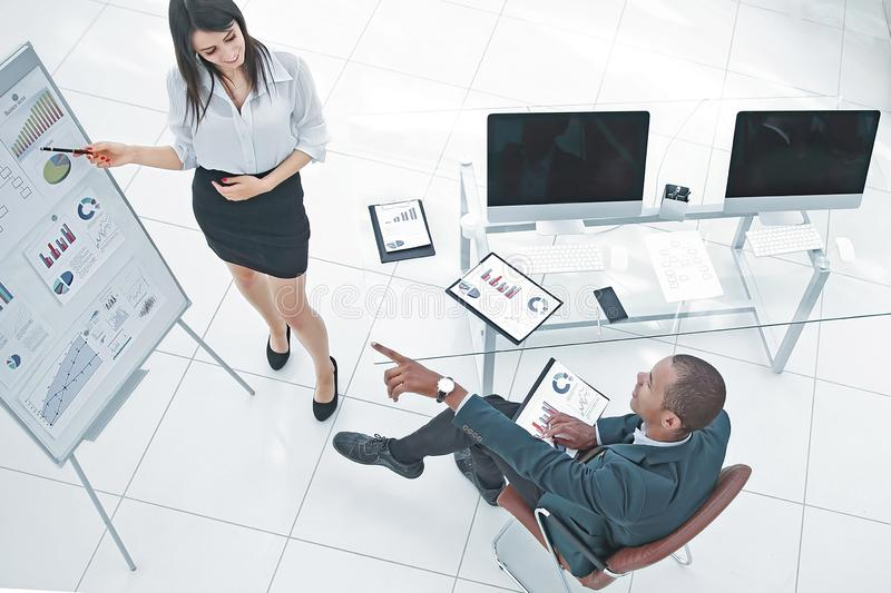 View from the top.young business woman making presentation of a new project stock images