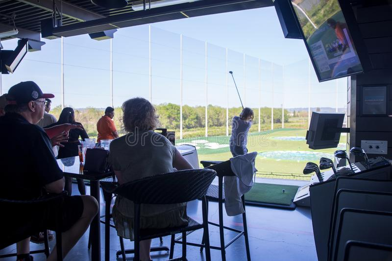View of TopGolf in Oregon, Entertainment venue with swanky lounge with drinks & games. Hillsboro, Oregon - May 11, 2019 : View of TopGolf in Oregon royalty free stock photography