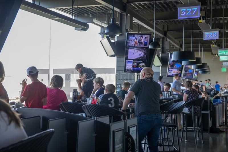 View of TopGolf in Oregon, Entertainment venue with swanky lounge with drinks & games. Hillsboro, Oregon - May 11, 2019 : View of TopGolf in Oregon stock image