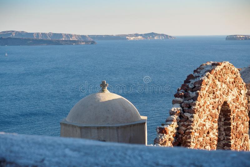 View of the tops of the ancient Greek church`s tower and wall stock photo