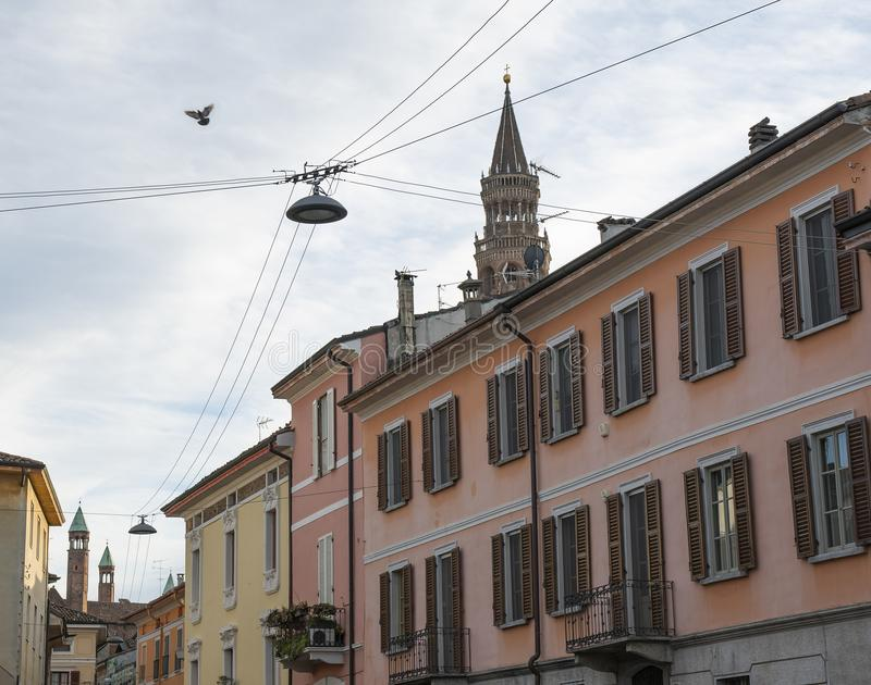 View of the Torrazzo of Cremona from one of the streets of the city center stock photo
