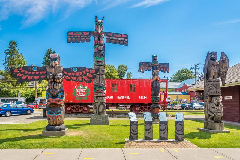 View of totems in Duncan - Canada. DUNCAN,CANADA - JULY 5,2018 - View of totems in Duncan. Duncan is `The City of Totems`. The city has 80 totem poles around the royalty free stock image