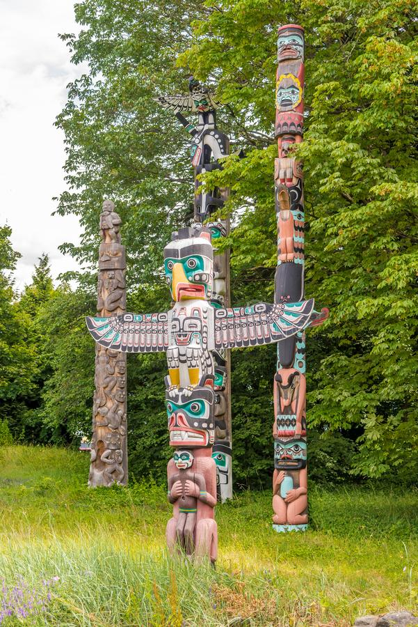 View at the totems in Stanley Park of Vancouver - Canada royalty free stock images