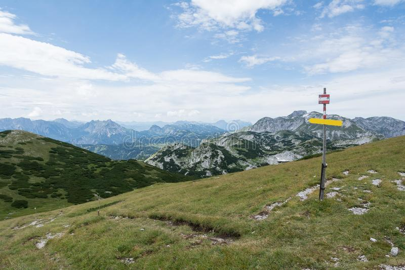 Tourist sign on mountain road, Alps. View of tourist sign on mountain road, Alps stock photography