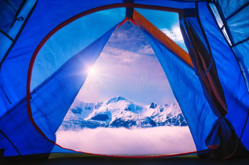 View from tourists tent to the high mountains stock photo