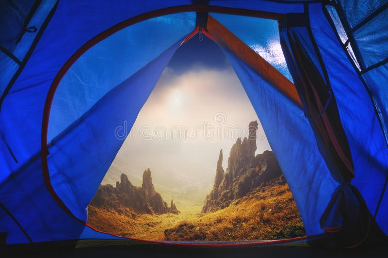 View from tourists tent to the rocky mountain stock images