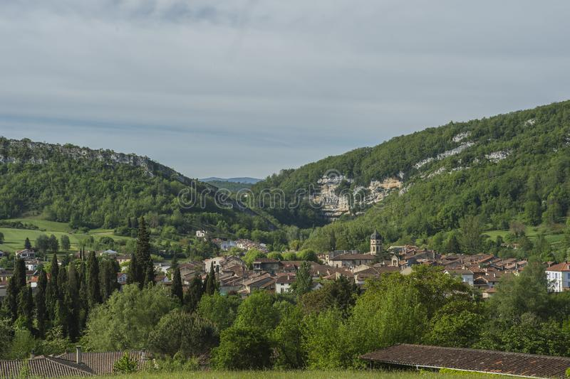 View towards ancient town of Ariege. View towards ancient town in Ariege, France, with blue sky and mountains in background stock photos