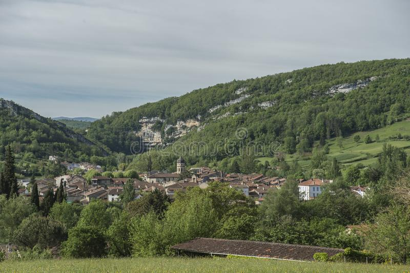 View towards ancient town in Ariege, France,. With blue sky and mountains in background stock photography