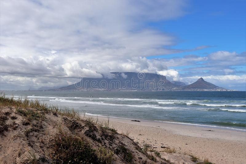 View towards Cape Town and Table Mountain from Bloubergstrand stock photo