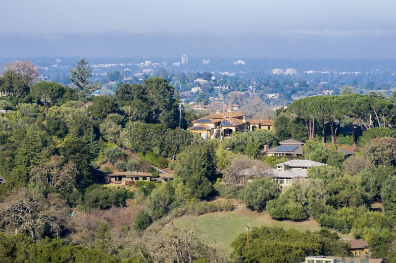 View towards the houses built in Los Altos hills. Mountain View and the San Francisco bay shoreline in the background, California royalty free stock image