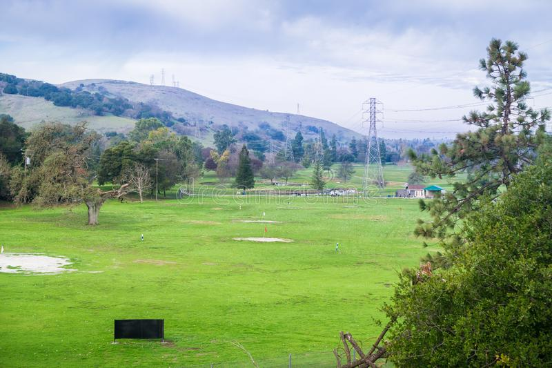 View towards the practice area in Santa Teresa Golf Course; golf balls covering the green, San Jose, south San Francisco bay stock images