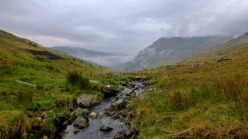 The view towards Snowdon from near Pen-Y-Pass, Wales. Nant Gwynant, Wales - May 1, 2019:  The view towards Snowdon from the A498 viewpoint climbing up to Pen-Y stock photography